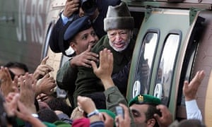 Palestinian leader Yasser Arafat boards a helicopter in October 2004, a month before he died