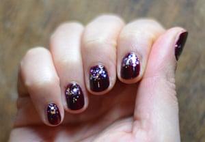 Dark nail polish with glitter