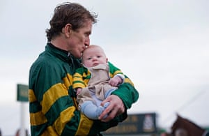 Tom Jenkins Pix of Year: AP McCoy kisses his baby son Archie after his 4,000th victory