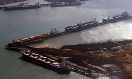 Ships waiting to be loaded with iron wait at Port Hedland in the Pilbara region of Western Australia