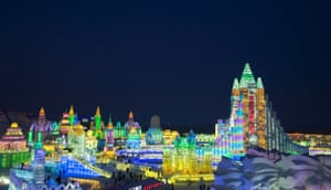 A general view of large ice sculptures at the 15th Harbin Ice and Snow World which shows the lighting scene at Sun Island, in Harbin city, Heilongjiang province, northern China
