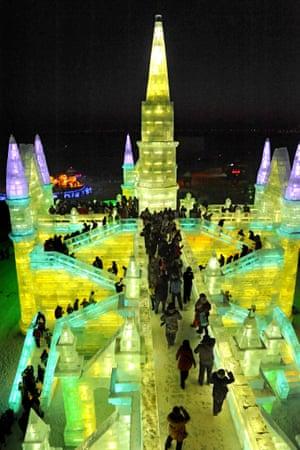 Visitors walk past ice sculptures