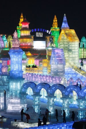 People view the large-scale ice sculptures at the 15th Harbin Ice and Snow World in Harbin, Heilongjiang province, China.