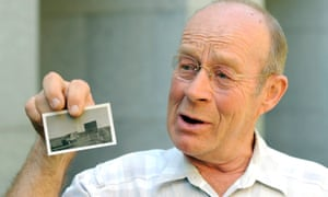 Maralinga veteran Geoffrey Gates displays a photograph from the Maralinga nuclear test site