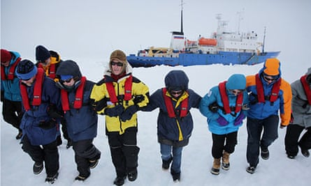 Scientists and passengers from the Akademik Shokalskiy stomp flat an area of ice