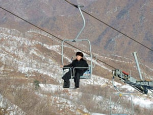 Kim Jong-un rides a ski lift at the Masik Pass