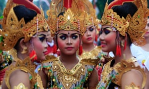 Balinese girls in traditional costumes gather during a parade for the year's last sundown in Bali island, Indonesia.