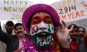 An Indian reveller poses on New Year's Eve in Amritsar.