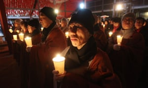Seoul, South Korea: Buddhist monks hold candles during celebrations at Bongeun Buddhist temple.