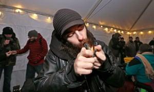 A man lights a joint