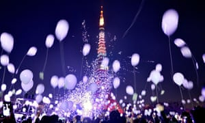 Tokyo, Japan: People release balloons to celebrate the New Year during the annual countdown ceremony by the Prince Park Tower.