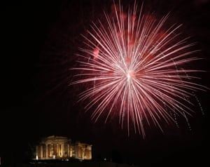 Athens, Greece: Fireworks explode over the temple of the Parthenon atop the Acropolis hill during New Year's Day celebrations.