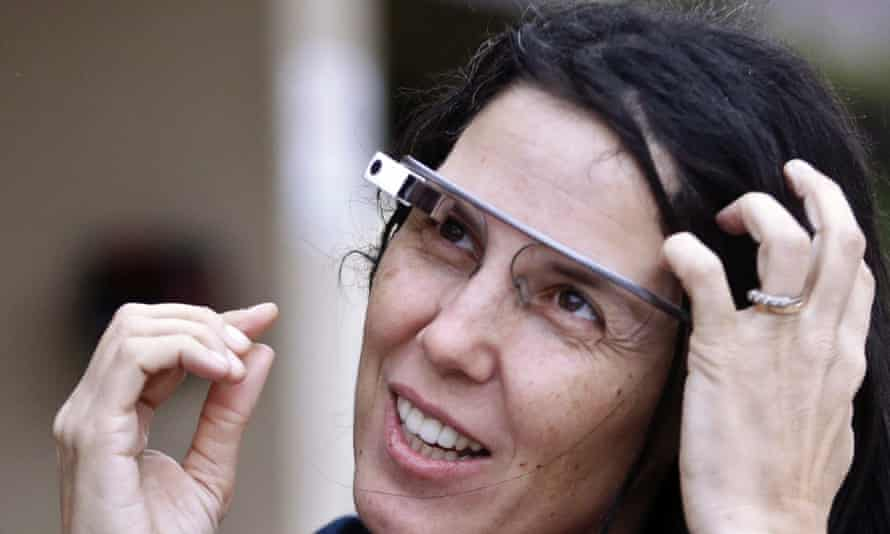 Cecilia Abadie wears her Google Glass as she talks to her attorney outside a Californian traffic court on Tuesday