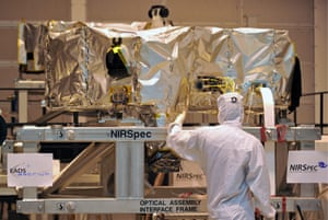 A staff member of EADS Astrium GmbH works at the Near Infrared Spectrograph (NIRSpec) in a clean room in Munich, Germany, 14 October 2009. The NIRSpec weighs some 200 kilograms and costs some 100 million euros. It was built for the James Webb Telescope (JWST) to discover weakest radiations in far off galaxies.