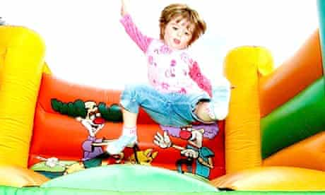 Child on bouncey castle