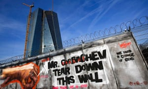 Graffiti on a fence surrounding the construction site of the new European Central Bank headquarters in Frankfurt. Photo: Reuters/Kai Pfaffenbach