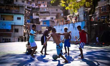 Boys play football in the Borel favela