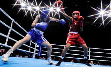 Two women boxing at a women's boxing test event