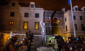 Members of the media gather around a statue of the late former South African President Nelson Mandela, which is illuminated behind a construction fence, outside the South African Embassy in Washington DC, USA, 05 December 2013.