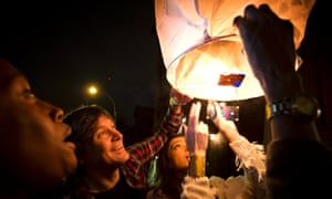 People release paper lanterns after lighting them outside Madiba, a restaurant named in honor of former South African President Nelson Mandela, in the Brooklyn borough of New York
