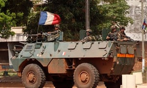 French soldiers patrol in their armoured personnel carrier during fighting in Bangui