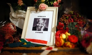 Flowers and tributes are left on the Nelson Mandela statue on Parliament Square in London, UK.