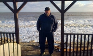 Robin Adams outside all that remains of his house at Hemsby, Norfolk.