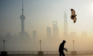 A man flies kite at The Bund on December 5, 2013 in Shanghai, China. Heavy smog continued to hit northern and eastern parts of China on Thursday, disturbing the traffic, worsening air pollution and forcing the closure of schools.