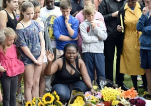 A group of people pay their respects outside the house of Nelson Mandela in Johannesburg.