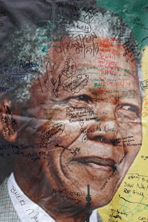 A poster with tribute messages is seen outside Nelson Mandela's former home in Soweto.