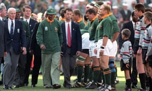Nelson Mandela greets the South Africa rugby team