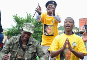 People sing and dance during a gathering of mourners on Vilakazi Street in Soweto.