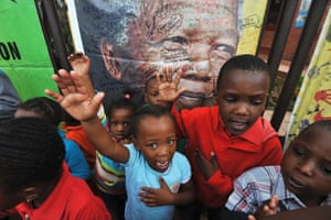 Children react during a gathering of mourners in Soweto.