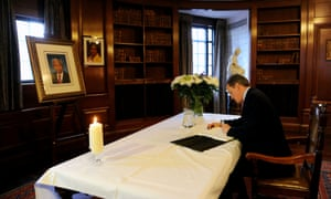 Prime Minister David Cameron signs a book of condolence at South Africa House in London, UK.