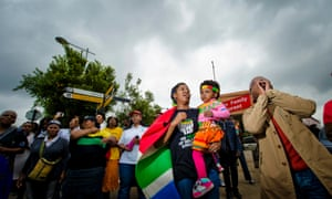 People gather on Vilakazi Street in Soweto, South Africa to commemorate Nelson Mandela's life.