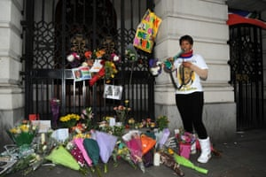 A mourner pays her respects to Nelson Mandela by playing the vuvuzela outside the country's High Commission in Trafalgar Square in London, UK.