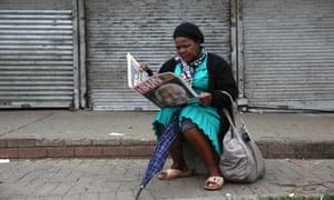 A woman reads of Nelson Mandela's death in Johannesberg, South Africa.