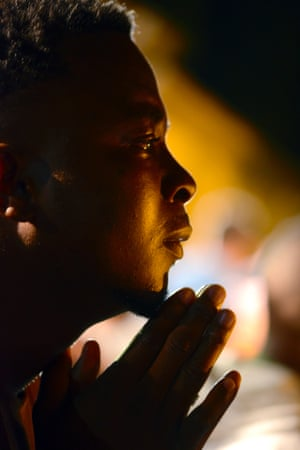 A man prays during a vigil outside the home of Nelson Mandela in Johannesburg.