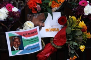 Floral tributes are left for Mandela at the South African High Commission in London.
