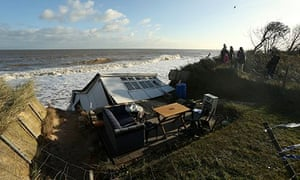 The scene where properties have fallen into the sea due to the cliff collapsing in Hemsby, England.