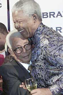 Nelson Mandela embracing Walter Sisulu in 2002