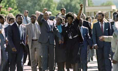Nelson and Winnie Mandela acknowledge the crowds cheering his release on 11 February 1990