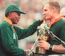 Springbok captain Francois Pienaar receives the Rugby World Cup from Nelson Mandela in 1995