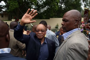 South African President Jacob Zuma waves as he arrives at Mandela's residence in Johannesburg.