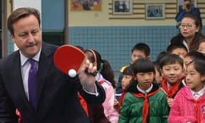 David Cameron plays table tennis with children in China