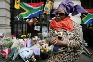 A woman mourns Mandela's death at South Africa House in London