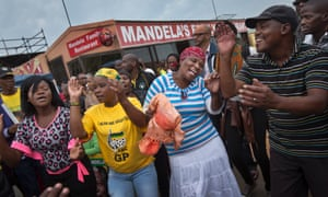 Mourners sing and dance to celebrate the life of Mandela in Soweto.