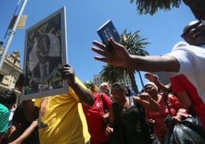 South African mourners sing and dance infront of the Cape Town City Hall where the late South African president Nelson Mandela made his first public address after being released in Cape Town, South Africa, 06 December 2013.