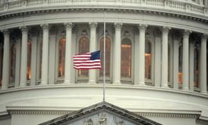 The US flag flies at half mast at the Capitol in Washington DC.