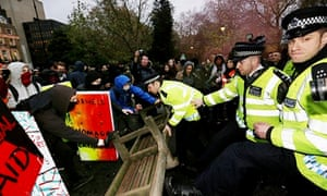 Police and protesters face off outside the University of London on Thursday